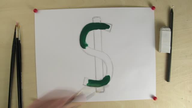 T/L CU Studio shot of hands painting dollar sign
