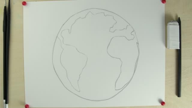 vídeos y material grabado en eventos de stock de t/l cu zi studio shot of hands painting earth - a la izquierda de