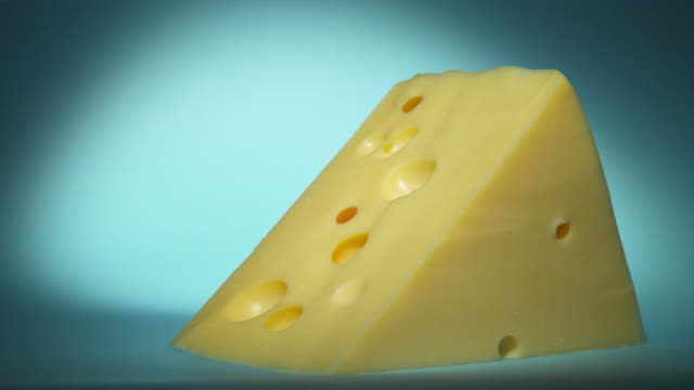 CU, Studio shot of large peace of Swiss cheese
