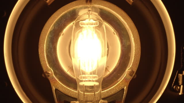 cu studio shot of light bulb in professional lighting instrument - filament stock videos & royalty-free footage