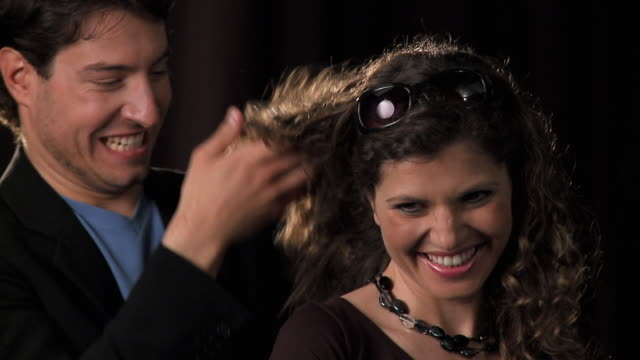 slo mo cu studio shot of loving couple, man playing with woman's hair, vrhnika, slovenia - vrhnika stock videos and b-roll footage