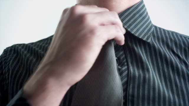 cu studio shot of man adjusting tie, mid section - necktie stock videos & royalty-free footage