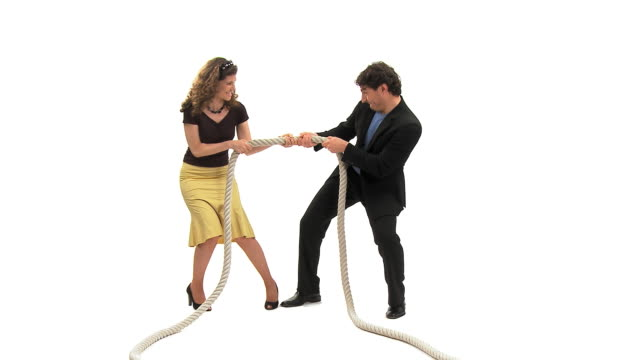 ws studio shot of man and woman playing tug of war, vrhnika, slovenia - vrhnika stock videos & royalty-free footage
