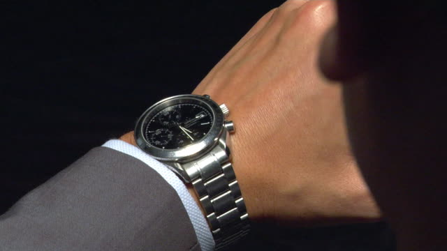 cu studio shot of man checking watch - wrist watch stock videos & royalty-free footage