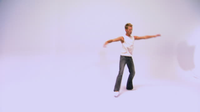 studio shot of man dancing - pirouette stock videos and b-roll footage