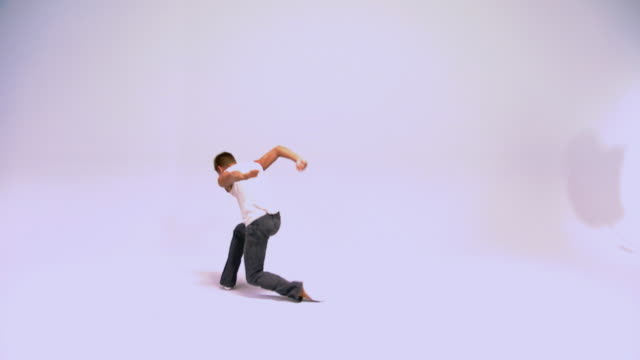 Studio shot of man dancing