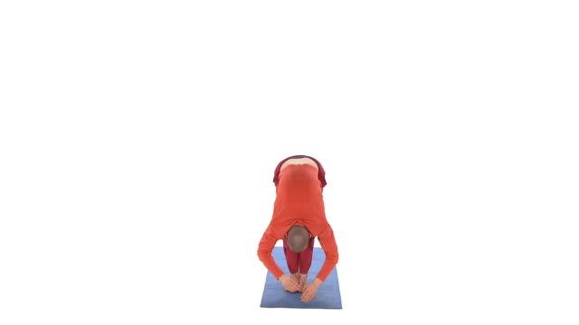 ws studio shot of man doing yoga sun salutation - sun salutation stock videos and b-roll footage