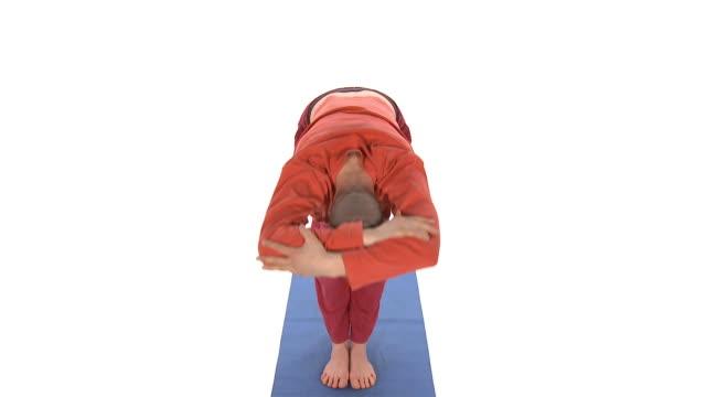 ms zo ws studio shot of man doing yoga sun salutation - sun salutation stock videos and b-roll footage