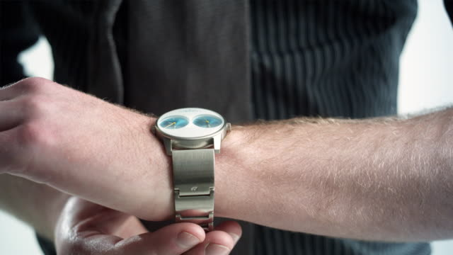 CU Studio shot of man fastening watch, close-up of hands