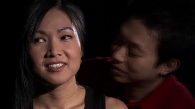 vídeos de stock, filmes e b-roll de cu studio shot of man kissing woman's neck / orem, utah, usa - camisa pólo