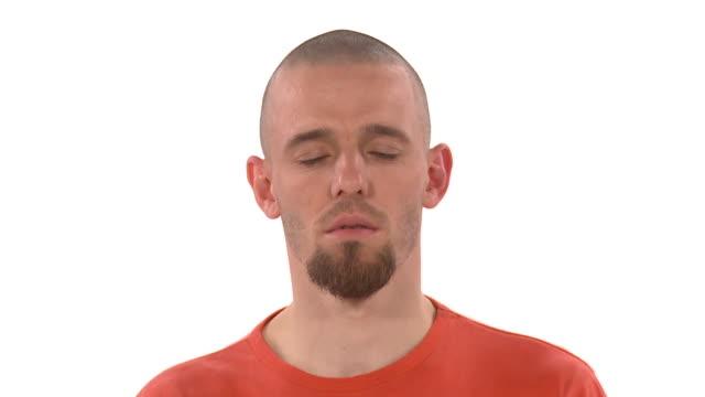 cu zo ws studio shot of man meditating in lotus pose - ziegenbart stock-videos und b-roll-filmmaterial