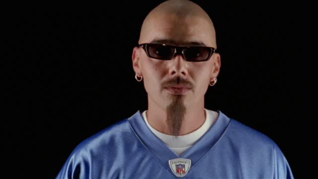 studio shot of man nodding head to hip-hop music - nodding head to music stock videos and b-roll footage