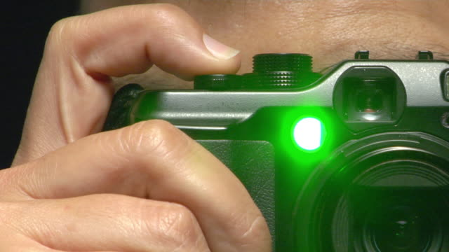 ecu studio shot of man's hand taking photo with compact camera - extreme close up stock videos and b-roll footage