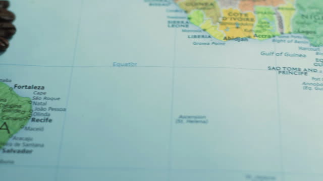 vidéos et rushes de cu pan studio shot of map of south america with coffee beans - south america