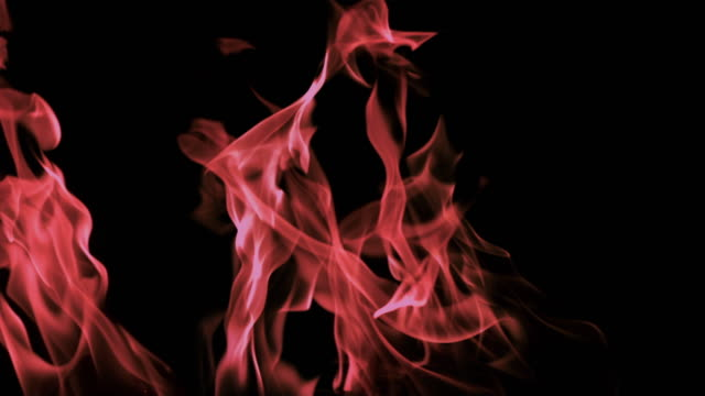slo mo ms studio shot of multicolored flames against black background - inferno stock videos & royalty-free footage