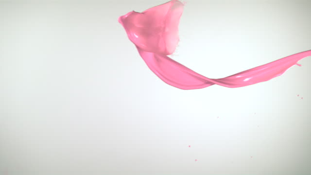 SLO MO, CU, Studio shot of pink paint splashing