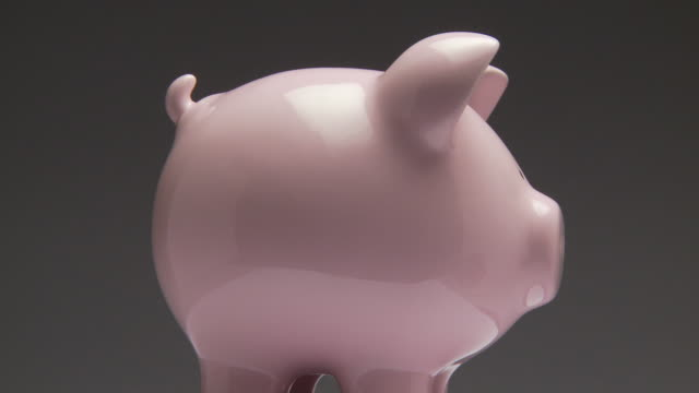 ms, studio shot of pink piggy bank rotating - man made object stock videos & royalty-free footage