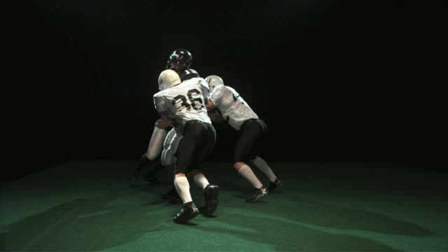 SLO MO MS Studio shot of quarterback throwing ball