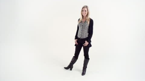 ws studio shot of smiling young woman - full length stock videos & royalty-free footage