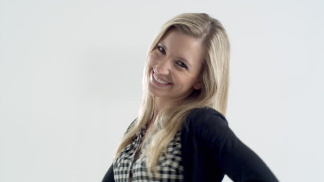 CU Studio shot of smiling young woman
