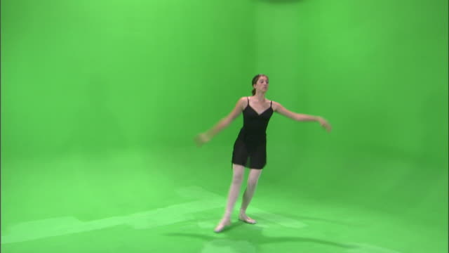 ws studio shot of teenage (16-17) ballerina dancing / orem, utah, usa - バレリーナ点の映像素材/bロール