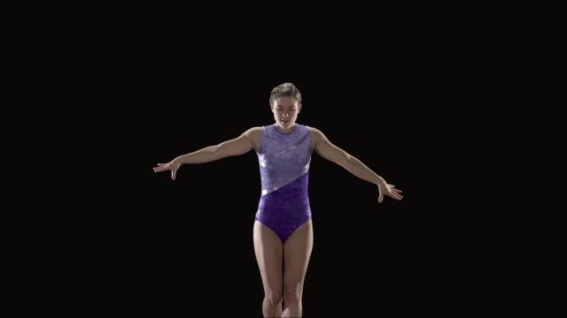 slo mo ms studio shot of teenage (16-17) rhythmic gymnast jumping - teenagers only stock videos & royalty-free footage