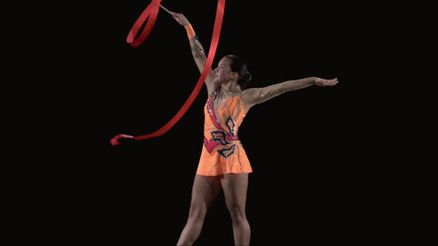 slo mo ms studio shot of teenage (16-17) rhythmic gymnast practicing with ribbon - teenagers only stock videos & royalty-free footage