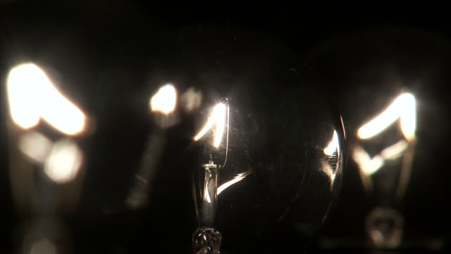 CU Studio shot of three light bulbs turning on