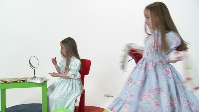 stockvideo's en b-roll-footage met cs ws studio shot of twin sisters (8-9) putting on makeup and spinning / orem, utah, usa - orem utah