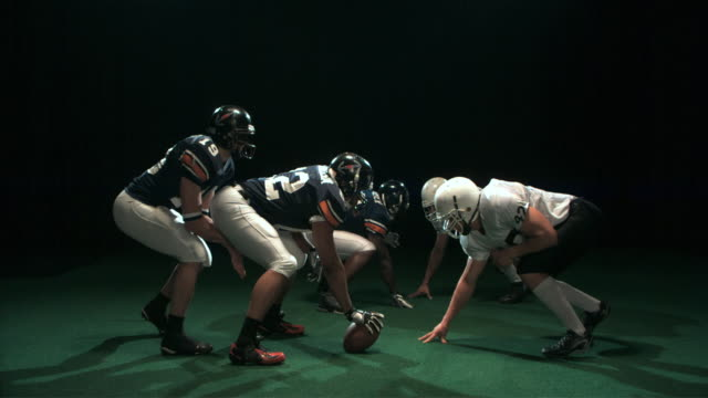 SLO MO WS Studio shot of two American football players in action