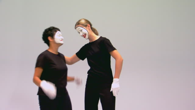 studio shot of two female mimes - mime artist stock videos & royalty-free footage