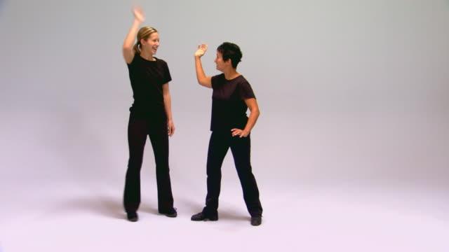 studio shot of two women mimes - mimare bildbanksvideor och videomaterial från bakom kulisserna