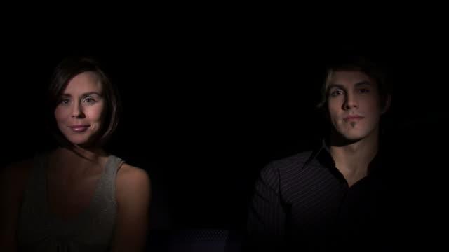 cu studio shot of young couple kissing / orem, utah, usa - ノースリーブトップ点の映像素材/bロール