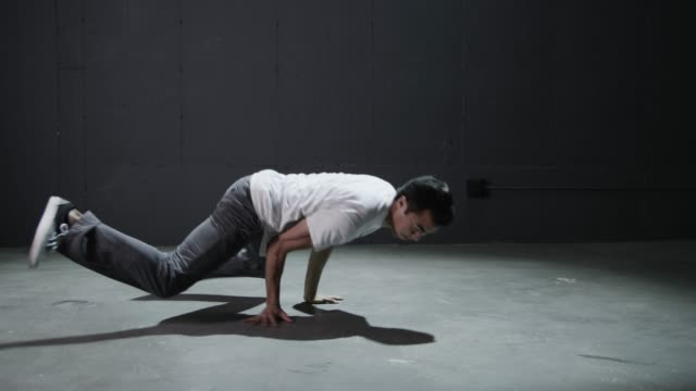 ws studio shot of young man breakdancing / orem, utah, usa - orem utah stock videos & royalty-free footage