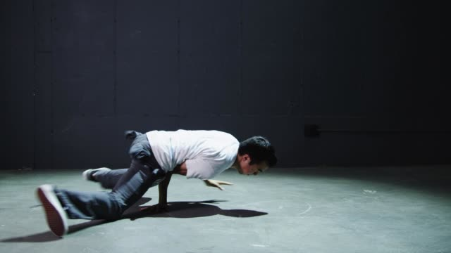 ws studio shot of young man breakdancing / orem, utah, usa - modern dancing stock videos & royalty-free footage