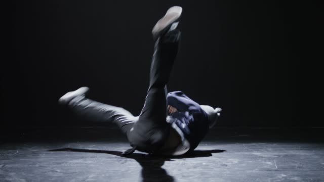 ws td studio shot of young man breakdancing / orem, utah, usa - パフォーマンス点の映像素材/bロール