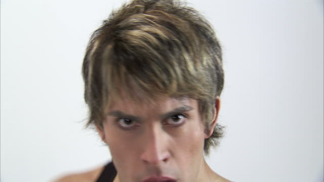 cu studio shot of young man punching towards camera / orem, utah, usa - ガーゼ点の映像素材/bロール