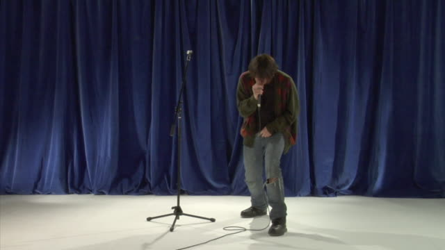 cu ws studio shot of young man singing and dancing - rebellion video stock e b–roll