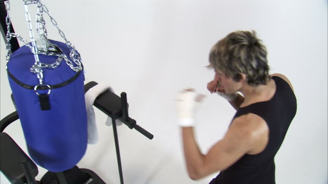 ms ha studio shot of young man training on punching bag / orem, utah, usa - ガーゼ点の映像素材/bロール