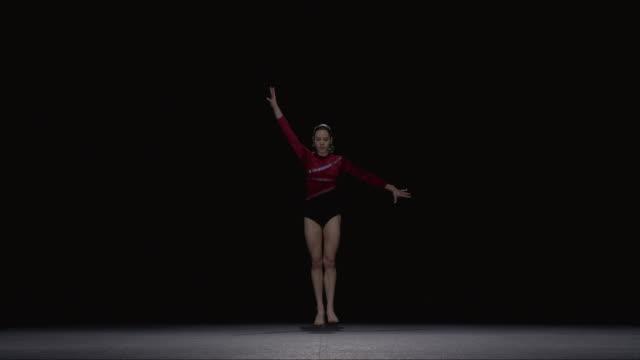 slo mo ws studio shot of young rhythmic gymnast jumping - acrobat stock videos & royalty-free footage