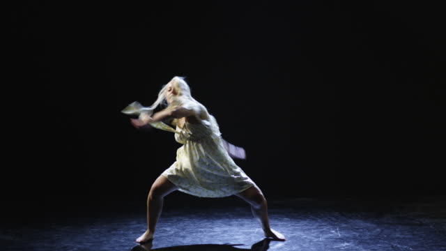 ws studio shot of young woman dancing - modern dancing stock videos & royalty-free footage