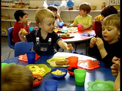 study finds many foods targeted at children are high in saturated fat salt and sugar england london hopes and dreams nursery group of children... - slice stock videos & royalty-free footage