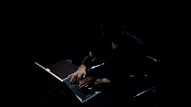Study finds more than 200000 people are victims of online dating scams R05120705 Man typing on computer laptop keyboard in dimlylit room