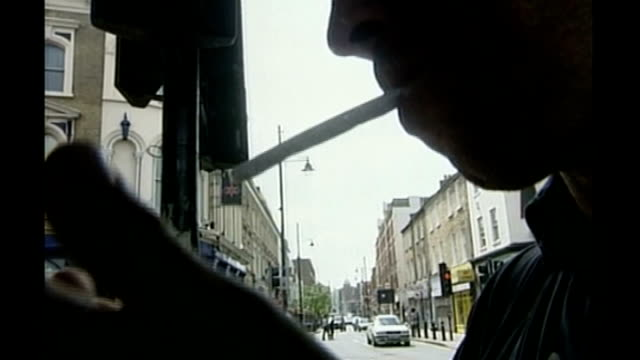 study finds 'skunk' cannabis linked to 25 per cent of psychosis cases t21030234 / tx london brixton ext man towards along street underneath bridge... - psychosis stock videos & royalty-free footage