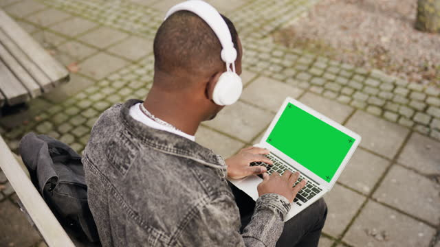 studying and listening to music - with chroma key green screen - over the shoulder stock videos & royalty-free footage