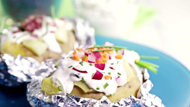 stuffed baked potato - sour cream stock videos and b-roll footage