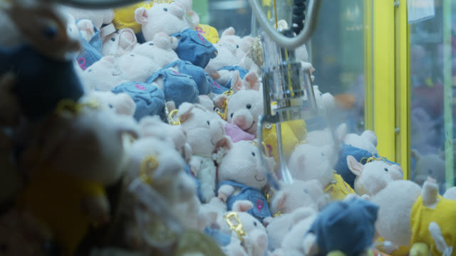stuffed toy pigs in mechanical claw game - construction equipment stock videos & royalty-free footage