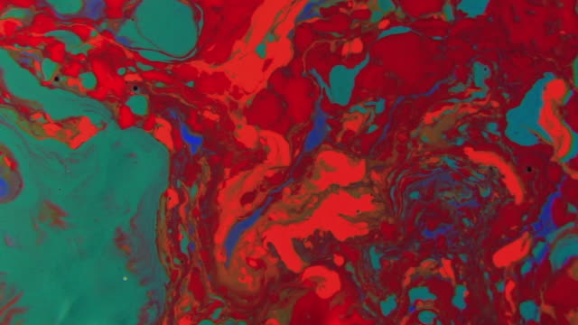 stunning abstract view of colorful paint flowing like lava creating new and surreal landscape taken from another planet. - mixing stock videos and b-roll footage