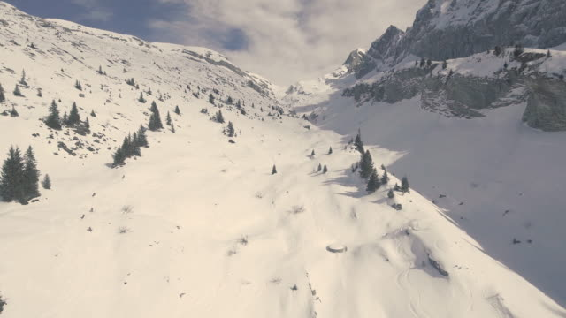 stunning aerial drone shots of downhill skiers on a off piste ski run in the french alps - downhill skiing stock videos & royalty-free footage
