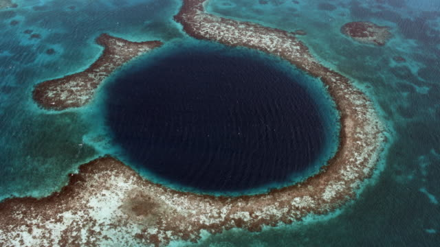 stunning aerial of great blue hole of belize - unesco world heritage site stock videos & royalty-free footage